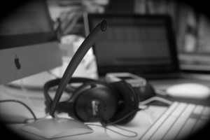 image of microphone, headphones, and computer